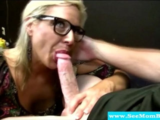 Hungry mature milf in spex sucking on dick